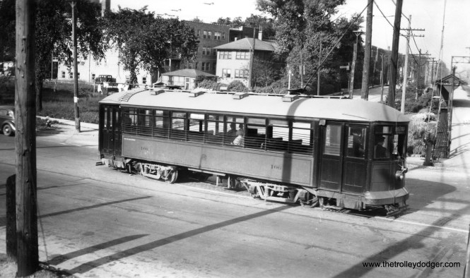 """C&WT 101 at the same location in 1936. Note the Harlem stop on the Burlington commuter line at right. Don's Rail Photos adds, """"101 was built by McGuire-Cummings in 1917. It was scrapped in 1948."""""""
