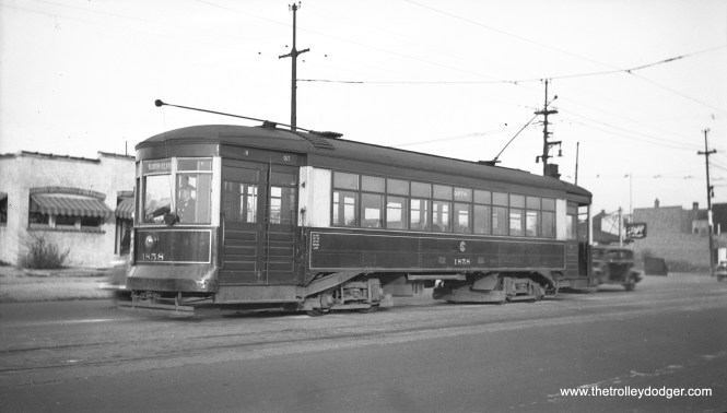 "CSL 1858 on North Avenue on July 3, 1940. Michael D. Franklin writes: ""There's enough here to say that this is North & Narragansett. The trolley bus wires are above the building to the right and angled onto Narragansett. The bus would have turned into the alley, gone around the bar with (Schlitz sign) and then make a left back onto North Ave heading east. Historical Aerials confirms all of this."" The North Avenue cars turned back on the west side of Narragansett. Between Narragansett and Cicero Avenue, there was two miles of shared wire between streetcars and trolley buses, unusual in Chicago. That was to permit Narragansett trolley buses access to the garage at North and Cicero."