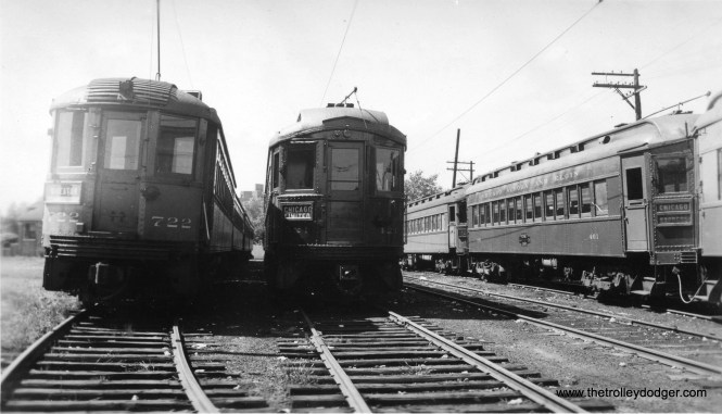 """Here is a very rare photo taken at Laramie Yards in 1936. At left we see North Shore Line car 722, heading up a four-car train and signed for Wheaton. CNS&M cars did, of course, operate on parts of the Chicago """"L"""" system, of course, but this is the first picture I have seen showing them at this location, posed next to CA&E cars 421 and 401. 722 was buit by Cincinnati Car Co. in 1926. I wonder what the occasion was that brought four North Shore Line cars to Wheaton? (Edward Frank, Jr. Photo)"""