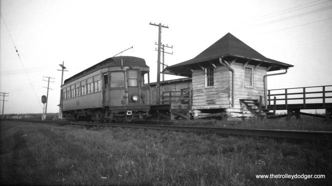 CA&E 141 on single-track private right-of-way at Batavia Junction on August 13, 1952. This was one of several woods that CA&E bought from the North Shore Line in 1946, after the latter decided it no longer wanted to run wood cars in passenger service. CA&E ran wood cars right up until the end of service.
