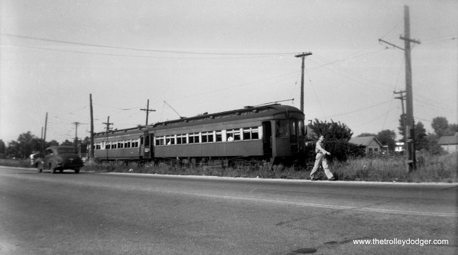 """A two-car train of 300-series woods on a July 8, 1949 fantrip. From the """"side of the road"""" location under wire, I would guess this is the Mt. Carmel branch along Mannheim Road."""