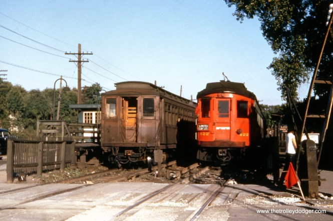"If I had to guess, I would say this picture of a CTA wooden ""L"" car and CA&E 422 was taken at DesPlaines Avenue, shortly before the September 1953 cutback in service. The old station was on the east side of DesPlaines Avenue."