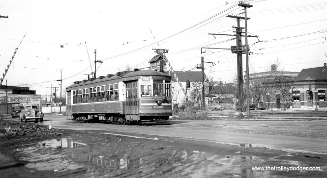 """CSL 6200 on the Windsor Park line. This was a Multiple-Unit car. Don's Rail Photos adds, """"6200 was built by CSL in 1924. It was rebuilt as one man service in 1932."""" Andre Kristopans adds, """"One funny thing about this location, when the CTA started the automated stop announcements on the buses, the southbound stop, which is where the B&O crossing was a bit south of 83rd Place, is announced as """"Commercial Avenue at Railroad crossing"""", even though the tracks have been gone since the 1970's sometime!"""" (Joe L. Diaz Photo)"""