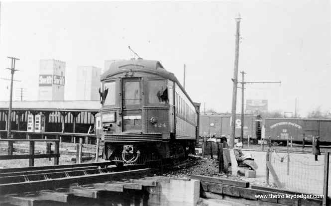 CA&E 424 loops at DesPlaines Avenue circa 1953-57, with a Chicago Great Western freight train in the background. We are looking north.