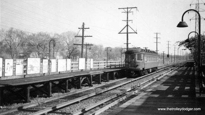 """CA&E 424 at Harlem Avenue on the Garfield """"L"""". Since this station was located on the west side of Harlem, it follows that this car is heading east. Fare control was on the inbound platform only. It, and Harlem Avenue, would be behind the photographer in this view. This area is now taken up by the Eisenhower Expressway."""