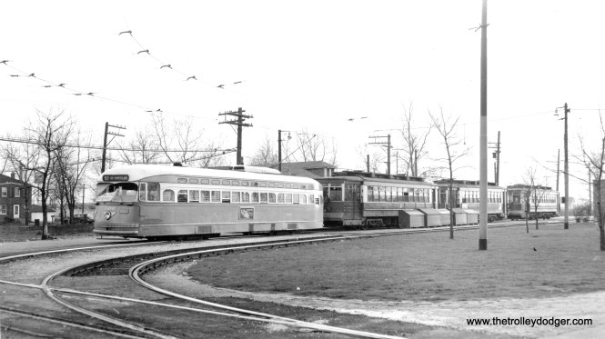 This picture (and the previous one) appears to have been taken in the latter days of streetcar service on 63rd. By then, most service was provided by red Pullmans, but some two-man postwar PCC cars were there too (such as 7261, seen here). The prewar PCCs had by this time been converted to one-man and were moved over to Cottage Grove.