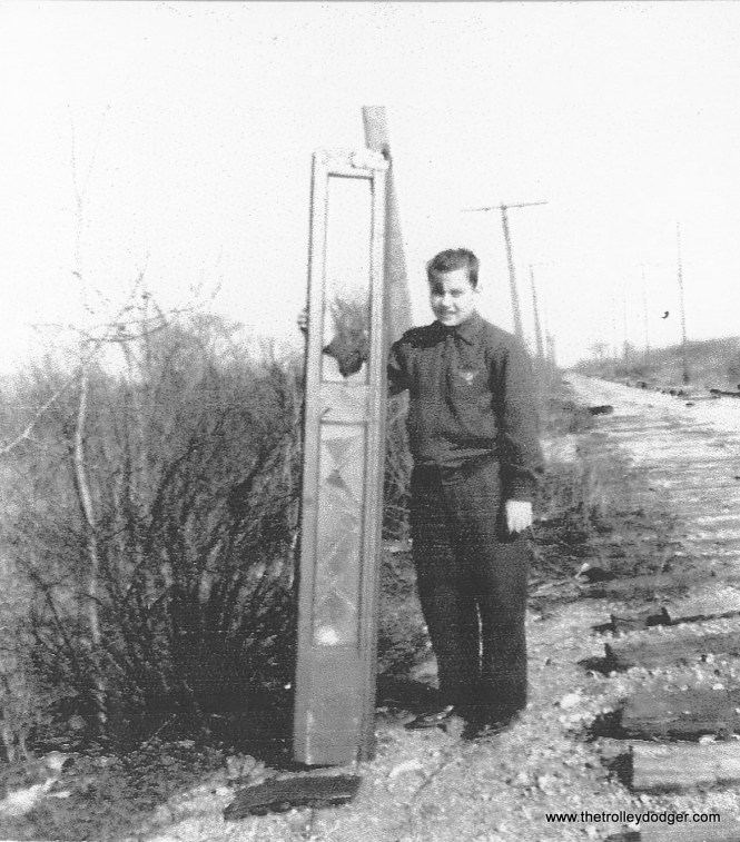 Two years have passed since the accident and the Speedrail line is being scrapped. Note the ties minus rails. Here we see Lee Brehmer (a friend of former Milwaukee resident Al Buetschle, who saved Milwaukee streetcar 978) at the crash site. holding up one of the doors from car 39. Today, the site has been completely obliterated by the National Ave. on and off ramps of the I-894 freeway.
