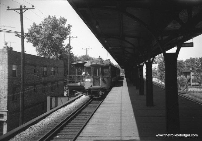 "On September 9, 1952, a southbound North Shore Line train, running via the Shore Line Route, stops at Foster Street in Evanston. Here, NSL had its own platform to keep passengers from transferring to the ""L"" without paying another fare. The stairs descended to a free area. It was not necessary to have a similar platform for northbound riders, as North Shore Line conductors would check tickets on the train."