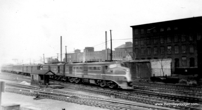 "Photo caption: ""New Have R. R. diesel passing Providence, RI engine house 12/21/47 with New York-bound train."""