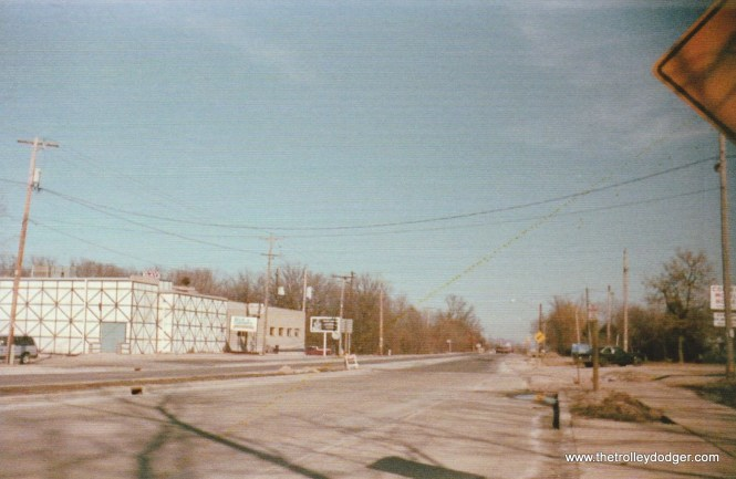 10B No trace of the College Ave. bridge or r.o.w. remains in 2017. Looking east on College Ave, the NSL crossed under College where the white building in the left background stands. March, 1988 C.N. Barney