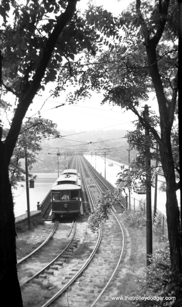 """Cars 19 and 36 on the Strawberry Mansion Bridge over the Schuykill River near Woodford Station on July 9, 1944. The bridge, built in 1896-97 for the trolley company, is still in use, but the section used by the streetcars has only recently been repurposed with a """"pedestrian promenade."""""""