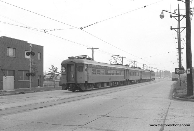 South Shore Line cars 107, 37, 27, and 5 are on east Chicago Avenue at Whiteoak Avenue in East Chicago on July 16, 1956. (James C. Barrick Photo)