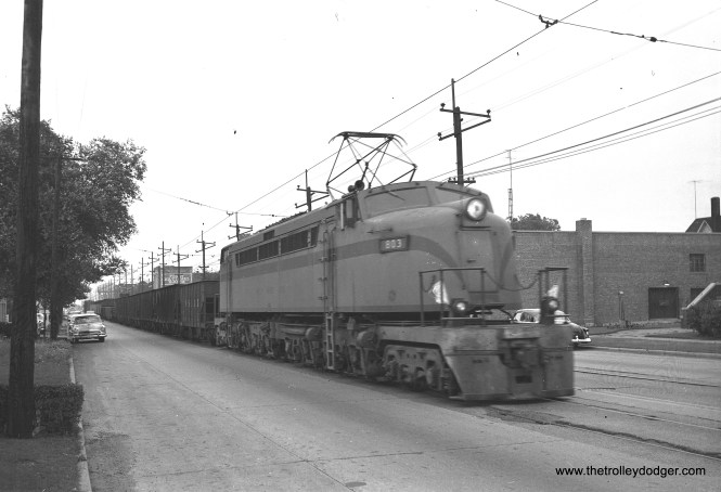 "South Shore Line ""Little Joe"" freight loco 803, with a train of 25 cars, is in the 1100 block of west Chicago in East Chicago on July 9, 1956. (James C. Barrick Photo)"
