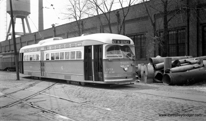 "CTA 7067 at South Shops on June 30, 1955. The ""Enter at Rear"" sign indicates this was a two-man car and was thus not one that had recently been assigned to Western Avenue. However, chances are the date I received is wrong, since George Trapp notes: "" The photo of PCC #7067 at South Shops shows the car brand new, note CSL logo, so should be dated around May 18, 1947 when that car was delivered, for some reason St. Louis Car cranked the side signs to HALSTED on there first order of Post War cars when shipping. I have a photo of car #7089 just delivered with same side sign."""