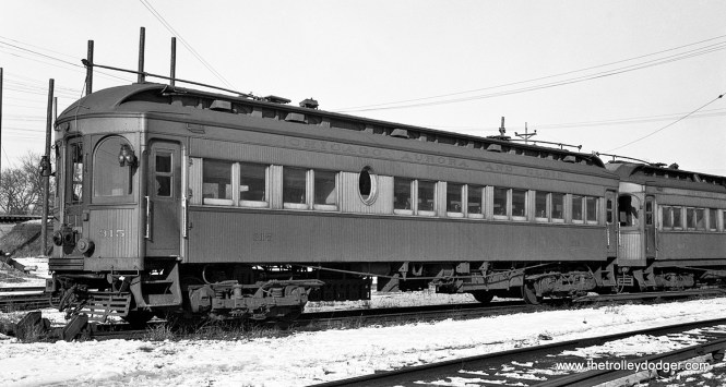 "CA&E cars 315 and 207. Don's Rail Photos: ""315 was built by Kuhlman Car Co in 1909, #404. It was modernized at an unknown date and sold to Rockhill Trolley Museum in 1962. 207 was built by Niles Car in 1904. It was rebuilt in September 1940 and retired in 1955."""