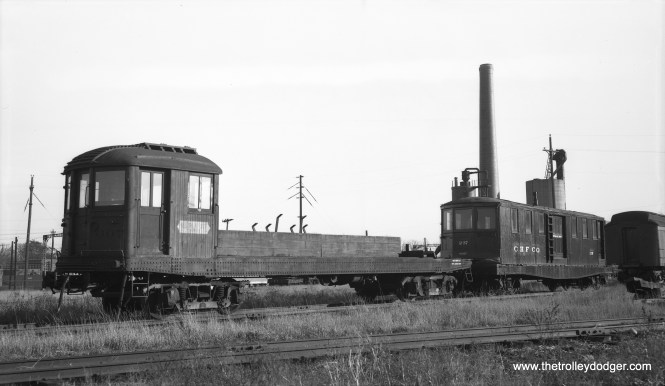 """Former North Shore derrick car 607 and car 237, both now owned by Chicago Hardware Foundry Co., at North Chicago, Illinois, November 14, 1953."" Don's Rail Photos adds: ""237 was built by Cincinnati in May 1924, #2720, as a merchandise dispatch car. It was rebuilt with 2 motors and later as a sleet cutter,"" and ""607 was built by Cincinnati in November 1924, #2730. It was retired in 1949 and sold to Chicago Hardware Foundry in 1950 and renumbered 239."" North Chicago was also the original home of the Illinois Electric Railway Museum. (Photo by Robert Selle)"