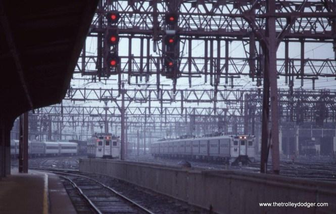 Photo 12. NJT Arrow MUs in the rain at Hoboken, NJ. 9-22-90.