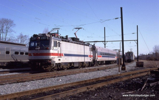 SEPTA AEM-7 2307 in the yard at West Trenton NJ. It will soon power a fan trip excursion around the Philadelphia area. 3-29-92.