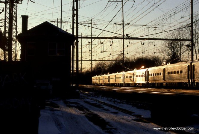 Photo 22. A train of NJT Arrow MUs reflect a winter sunset at it passes LINCOLN Tower at Metuchen NJ on January 12, 1997.