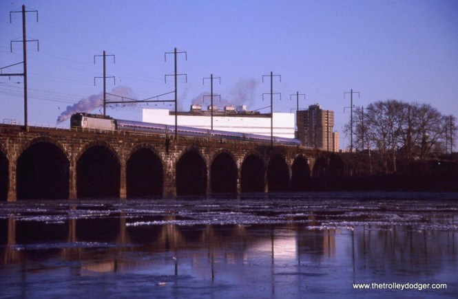 Photo 28 Amtrak AEM-7AC #948 on Keystone Train #661 crossing the Delaware River on the Ex-PRR bridge opened in 1903. Morrisville, PA. 1-10-10.