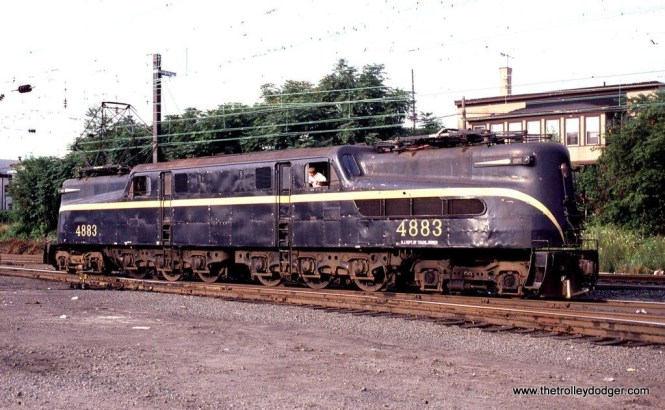 Photo 3 NJDOT GG-1 #4883 retains her yellow stripe that was applied in PRR days. South Amboy, NJ. 7-24-81.