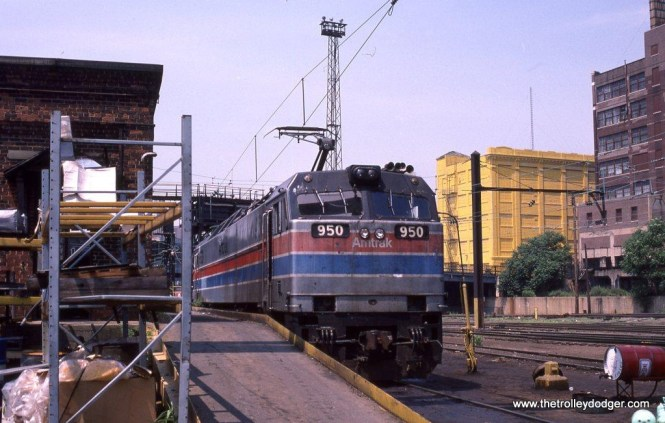 Photo 8. A tour of Amtrak's Sunnyside Yard in Queens, New York City on June 20, 1987 officered a rare opportunity to photograph behind the scenes operations there. This photo shows Amtrak E-60 950 at the engine house awaiting attention.