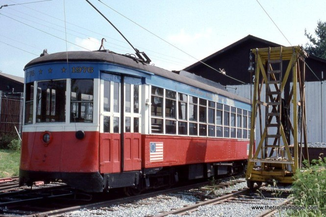 Third Avenue Railway System car 678 still wears her bicentennial paint scheme as she sits outside the car barn at the National Capital Trolley Museum in May of 1989. The car has since been repainted in the TARS color scheme of red and white.