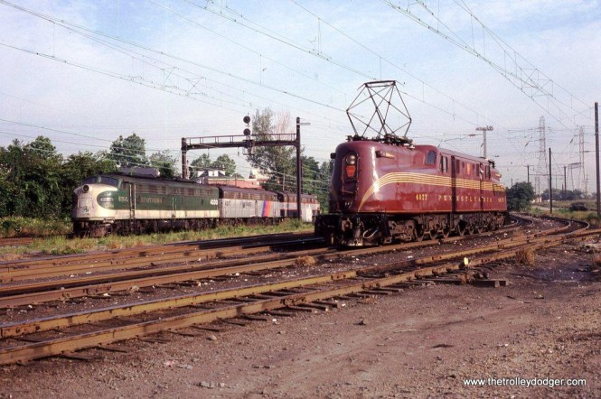 Photo 8. NJT restored Pennsylvania GG-1 #4877 and Ex-Southern E-8 #4330 at South Amboy on July 24, 1981. I have never visited Ivy City yard near Washington DC where PRR GG-1s were serviced along with passenger power from connecting Southern railroads, but I imagine this scene is not unlike what it looked like there before the coming of Amtrak.