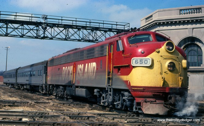 """Rock Island 650 on train #12 to Joliet on March 28, 1976. (Joseph Piersen Photo) M. E. writes: """"If this is indeed CRI&P train 12, the caption is wrong. I plugged """"CRI&P train 12"""" into Google and up came the Peoria Rocket. The passenger cars shown were never commuter cars; they were on trains that went farther than Joliet. Perhaps this caption should say, 'The Rock Island's train 12, the Peoria Rocket, arrives in Joliet.' By the way, the Rock Island never turned over its passenger service to Amtrak. After Amtrak formed, the CRI&P ran its own passenger trains from Chicago LaSalle St. station to Peoria (""""Peoria Rocket"""") and from Chicago to Rock Island (""""Rock Island Rocket""""). They were never very busy, so they had only one or two cars."""""""