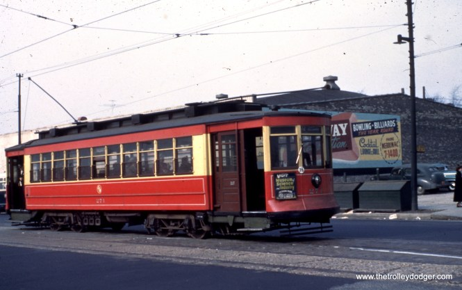 """CTA red Pullman 271. Andre Kristopans adds, """"Pullman 271 at North just west of Narragansett. C&WT (Chicago & West Towns) bus just barely visible in rear would have been on 11-Oak Park route."""""""