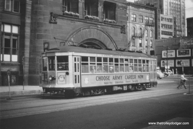 """An 800 series car advertising the benefits of an """"Army Career"""" passes Milwaukee City Hall northbound on N. Water Street. (Larry Sakar collection)"""