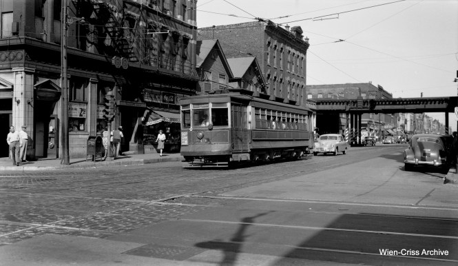 "CTA Pullman 643 is westbound at North and Halsted on August 14, 1948. That section of ""L"" at the rear, part of a section known as the ""triple curve,"" is still there today, and is used by Brown and Purple Line trains. (Robert Selle Photo, Wien-Criss Archive)"
