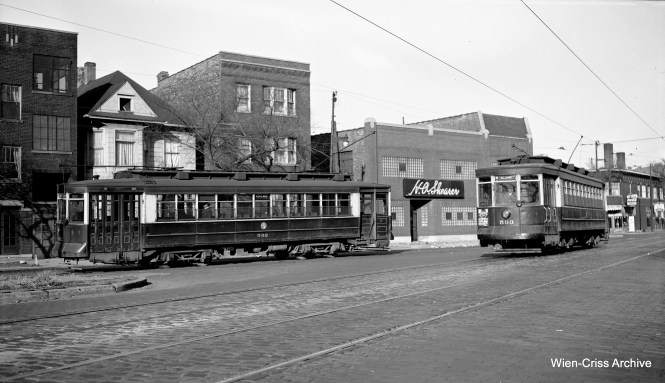 In this November 4, 1952 view, CTA 593 is on Clark Street, heading south to the Limits car barn, while car 562 is on Southport, the north end of the Ashland route. (Robert Selle Photo, Wien-Criss Archive)