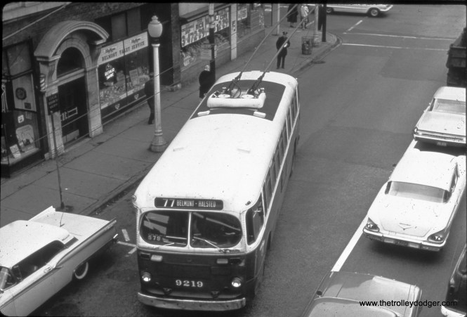 """CTA trolleybus 9219 on Route 77 - Belmont, running eastbound at approximately 952 W. Belmont (near Sheffield). The photographer was up on the north-south """"L"""" platform. (William Shapotkin Collection)"""