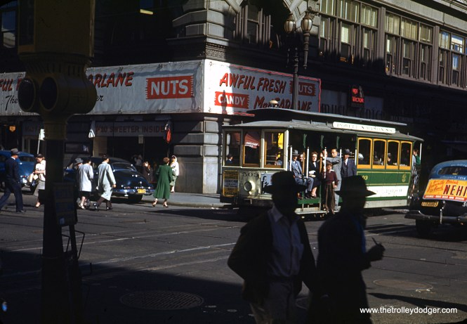 """Early Kodachrome images such as this are rare. Here, we see a San Francisco cable car (signed for Powell and Mason) in operation during the summer of 1945. When this picture was taken, the war in Europe had ended, but the US was still fighting Japan. According to the Cable Car Museum web site, this car is currently in service as #3: """"Built by the Carter Bros. of Newark, California during 1893-1894 for the Market Street Railway's Sacramento-Clay cable car line. The United Railroads transferred it to the Powell Street cable car lines in 1907, after the Earthquake and Fire of 1906. Until 1973, numbered as No. 503. No. 3 is painted in Muni's green and cream paint scheme, which is based on the green and white scheme of the Muni's former rival between 1921-1944, the Market Street Railway. This was the basic paint scheme for Powell Street cable cars from 1947 to 1982. Extensive rebuilding, by Muni 1955."""""""