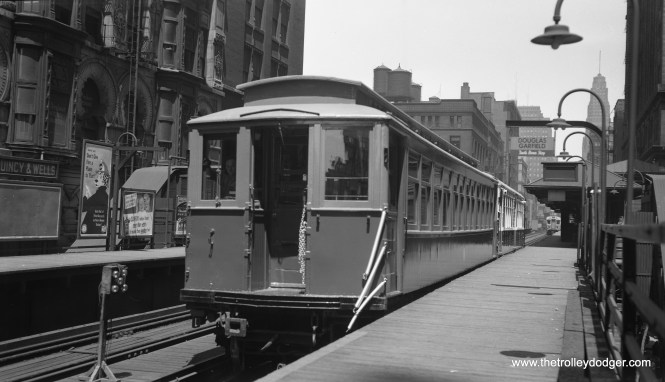 """Here's what photographer Bob Selle wrote on this negative envelope: """"""""L"""" cars fresh from the paint shops, MU-coupled, for trip to South side """"L"""" lines: deck roofer 2912 and steel car 4224 at Quincy and Wells platform. June 14th, 1955."""""""