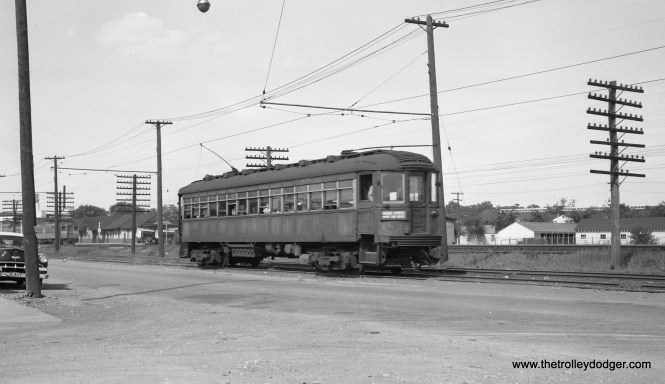 """North Shore Line car 182 is southbound on the Shore Line Route in North Chicago, Illinois on June 12, 1954. Don's Rail Photos: """"182 was built by Cincinnati Car in September 1920, #2455."""" (Robert Selle Photo)"""