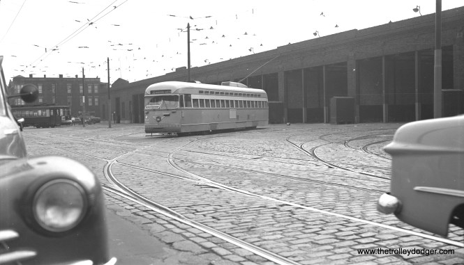 CTA Pullman-built PCC 4084 leaving the Kedzie Station (car barn) on September 13, 1950. The car at right appears to be either a 1949 or 1950 Ford. My father had a 1949 model, and as cars were very much in demand after the end of World War II, the dealer put him on a waiting list. After being on the list for six months, he found that he had actually gone further down the list than he was at the start! So he wrote a letter complaining about this to Henry Ford II, and the next thing you know, they sold him a car. Presumably the PCC is heading out on Route 20 - Madison. (Robert Selle Photo)