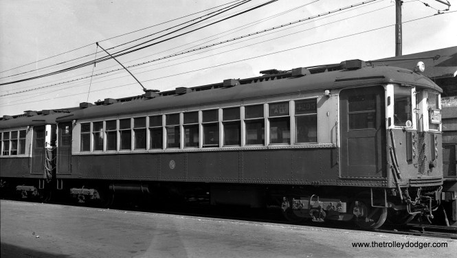 "CTA 4295 heads up a train in Oak Park on the ground-level portion of the Lake Street ""L"" on August 7, 1954. (Photo by Mark D. Meyer)"