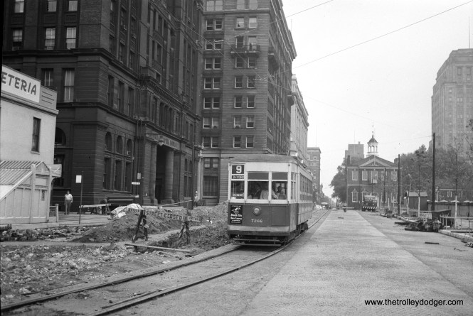 """Philadelphia Transportation Company 7266 is on Route 9, sometime in the 1950s during street construction. Micheal T. Greene writes: """"The Route 9 car is on 5th Street south of Market Street. At this time, 5th Street was being widened as part of Independence Mall. Independence Hall is out of this picture to the right."""""""