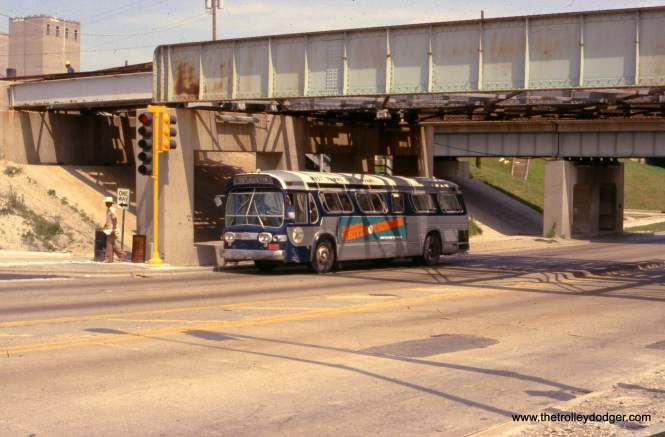 Chicago & West Towns 848 at the DesPlaines Avenue CTA terminal on August 7, 1980. The second overpass, behind the bus, was for the Chicago Great Western freight line. That bridge and tracks have since been removed. (Ronald J. Sullivan Photo)