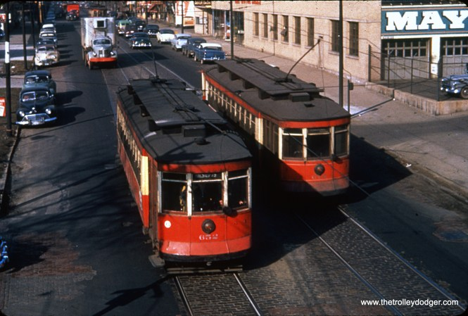 CTA 652 and 678 pass each other at Halsted and 75th on February 22, 1954. (James J. Buckley Photo)