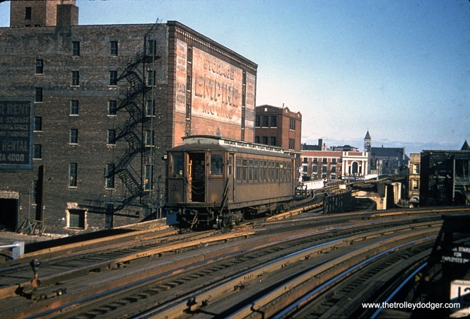 This photo shows an old wooden Met car on the CTA's Kenwood shuttle in the 1950s. The view looks east from the Indiana Avenue station. The south side main line continues off to the right. Service on the Kenwood branch ended in 1957.