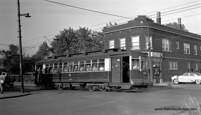 "Bob Selle: ""CTA car 115 northbound on Kedzie Street line at 35th and Kedzie, July 23, 1953."" Daniel Joseph adds, ""I do not believe this photo is at Kedzie & 35th Street. 35th Street never went to Kedzie and 36th Street had street car tracks."""