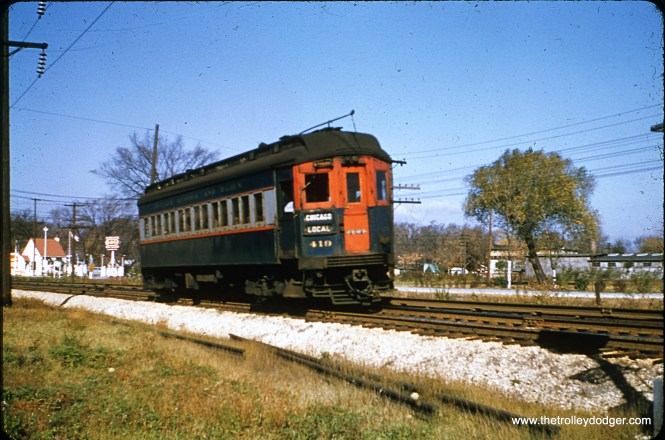 Chicago Aurora & Elgin 419 is eastbound in June 1952, just east of First Avenue in Maywood.