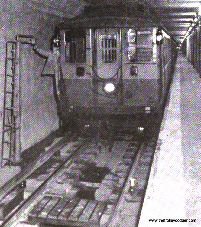 CRT motorman Charles R. Blade activates a signal override in the State Street Subway, early in 1943.