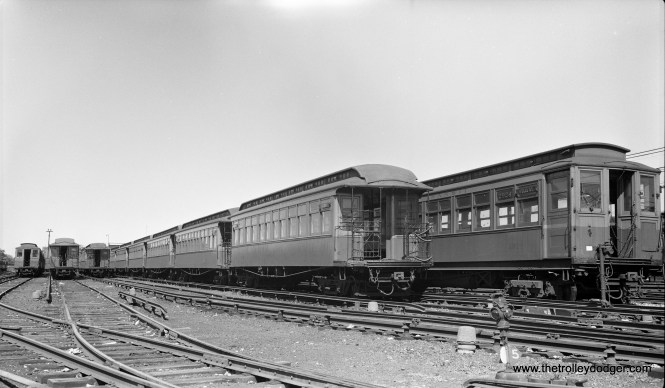 """CTA gate cars and Met cars are on display at Laramie Yard in this August 1948 view (on the Garfield Park """"L"""")."""