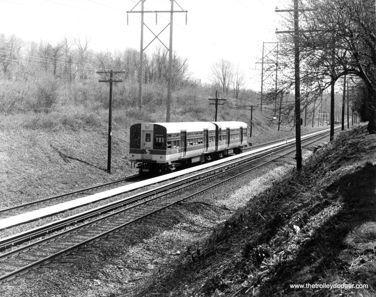 """After serving Chicago for many years, some of the original CTA """"flat door"""" 6000s had a second life on Philadelphia's Norristown High-Speed Line. 6089-6090 are approaching Radnor on April 10, 1987."""
