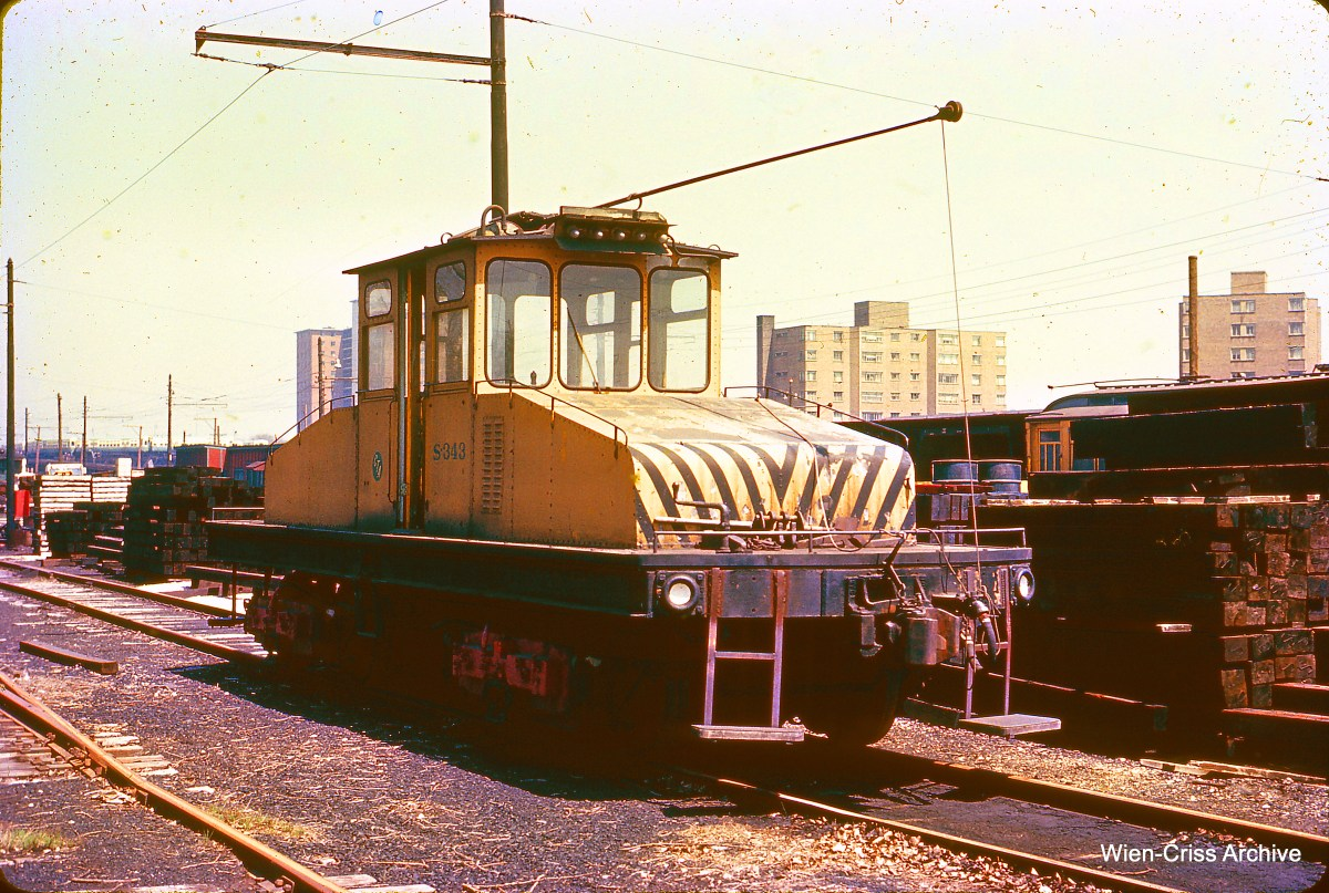 """CTA steeple cab S-343, a """"yard shifter,"""" serving the rapid transit system, is at 64th and Prairie. Don's Rail Photos notes, """"S-343 was built by Chicago City Ry in 1909 as Chicago City Ry C50. It was renumbered L202 in 1913 and became CSL L202 in 1914. It was rebuilt as S-343 in 1959 and acquired by Railway Equipment Leasing & Investment Co in 1979. It was acquired by Fox River Trolley Museum in 1983 and restored as L202."""" (Wien-Criss Archive)"""