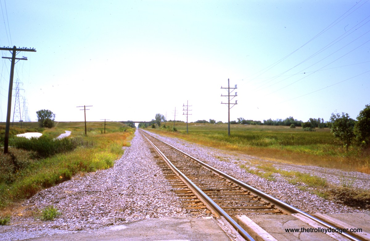 """Milwaukee, WI - Looking SB on UP (ex-C&NW) """"New Line"""" from """"Old Ryan Road"""" (new Ryan Road is visible overhead in the distance). This once double-tracked line once crossed the long-abandoned CNS&M at """"Ryan Tower,"""" located south of the Roadway. Photo by William Shapotkin on September 6, 2003."""